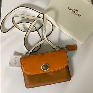 Coach crossbody leather wallet. Brand new w tags!